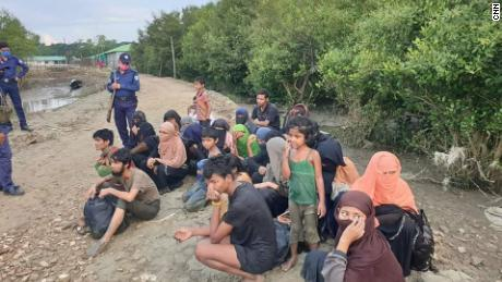 Dozens of refugees are stranded at sea to be quarantined on a controversial island