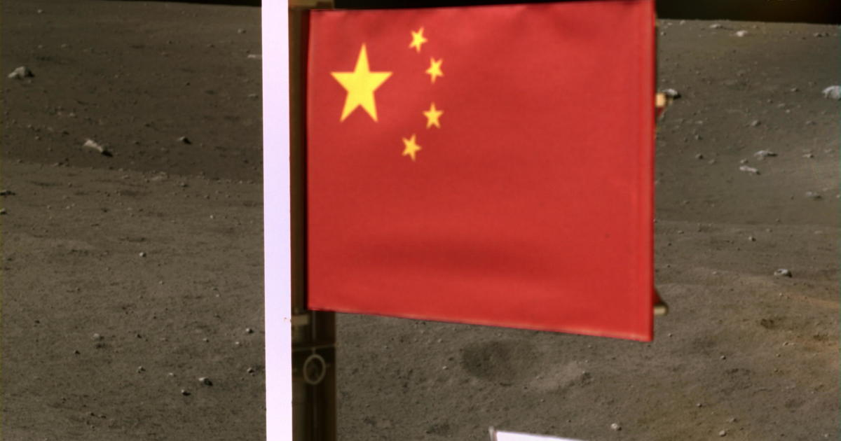 China publishes an image of its flag on the moon while lifting a spacecraft carrying moon rocks