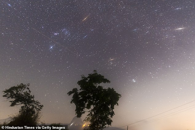 More than 100 multicolored stars are scheduled to spread across the night sky this weekend during the peak of the Geminid meteor showers.  Pictured is the Geminid meteor showers seen from Lake Bauna near Lonavala on December 14, 2017 in Mumbai, India