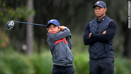 Tiger Woods watching his son, Charlie.