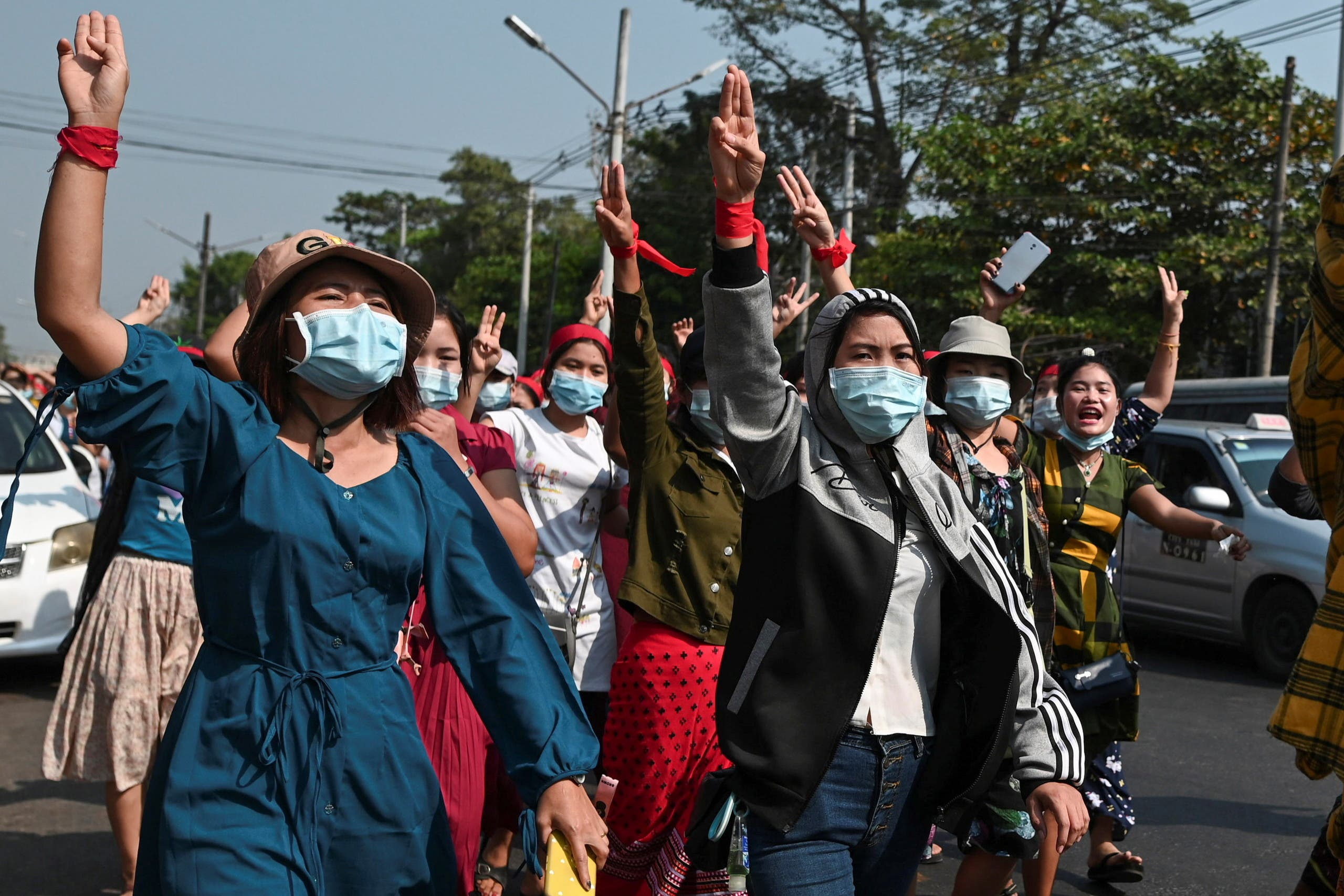 People protest in a street against the military coup in Myanmar