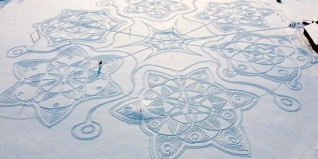 Stepping on the ice, they create artwork in Finland