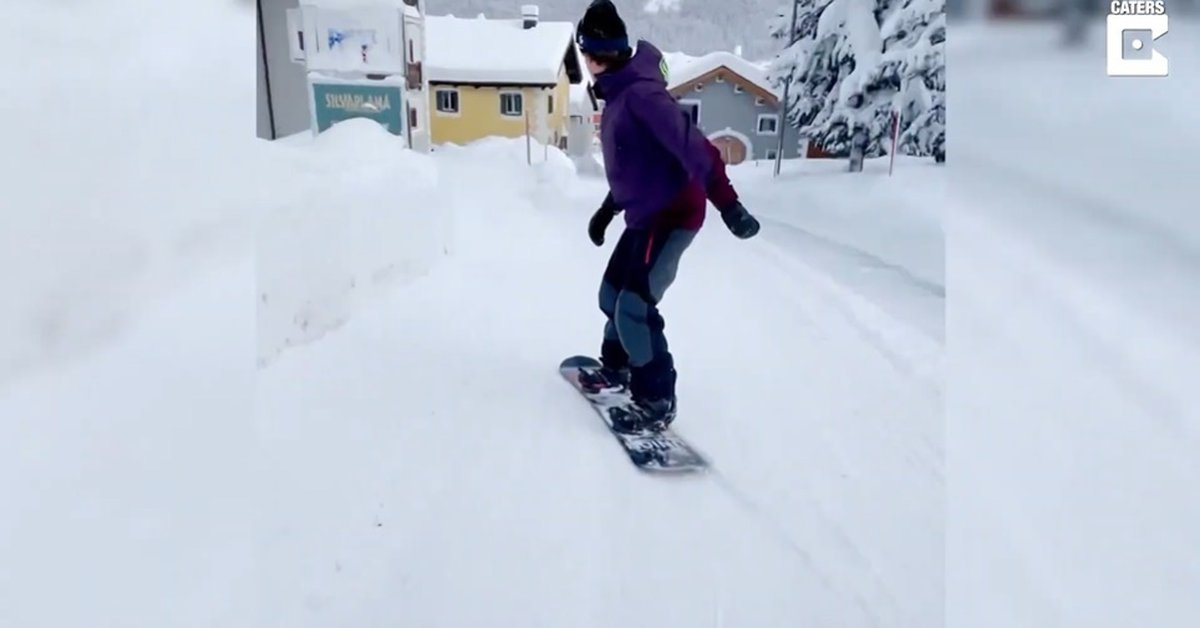 Disconnect.  – This man is skiing in the snow-covered streets of Switzerland