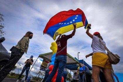 Venezuelans in Doral Central Park, in Doral, Miami-Dade, Florida, celebrate the TPS announcement