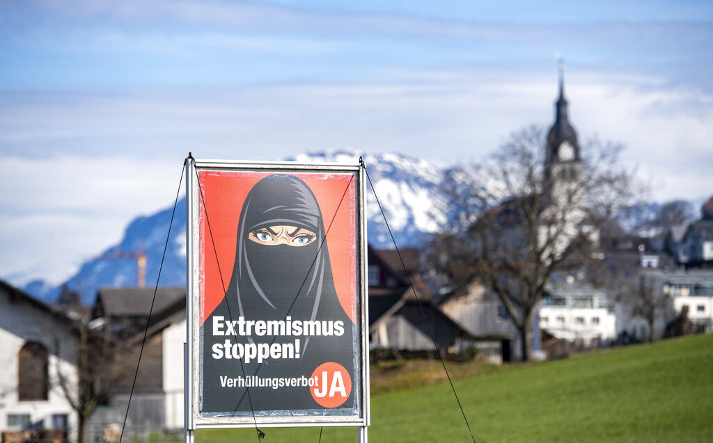 Switzerland approves banning the burqa and masking the face in public places