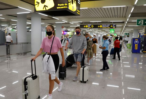 Passengers arriving at Palma de Mallorca Airport on July 30, 2020 in Mallorca, Spain