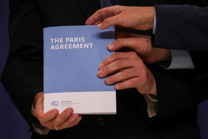 A copy of the Paris Agreement during the United Nations Climate Change Conference (COP25) in Madrid, Spain, on December 13, 2019 (Reuters)
