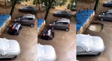 The parked car suddenly fell into a ditch.  Viral video |  viral video |  car |  Mumbai |  Mathrubhumi Online