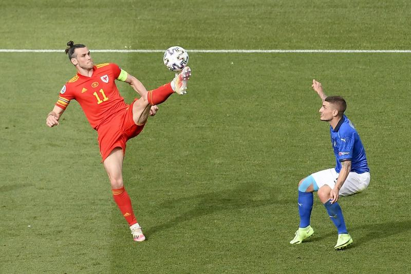 Gareth Bale controls the ball during the match between Italy and Wales