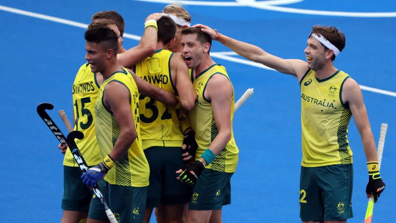 Australia and Germany won their matches in the men's hockey championship