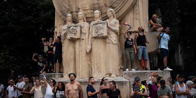 Demonstrators chant slogans during a demonstration in Marseille, southern France, on Saturday, August 7, 2021.