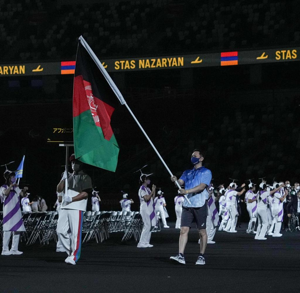 The flag of Afghanistan is raised at the opening ceremony of the Tokyo 2020 Paralympic Games at the Olympic Stadium in Tokyo, August 24, 2021 (Photo by Yasuchi Chiba/AFP)