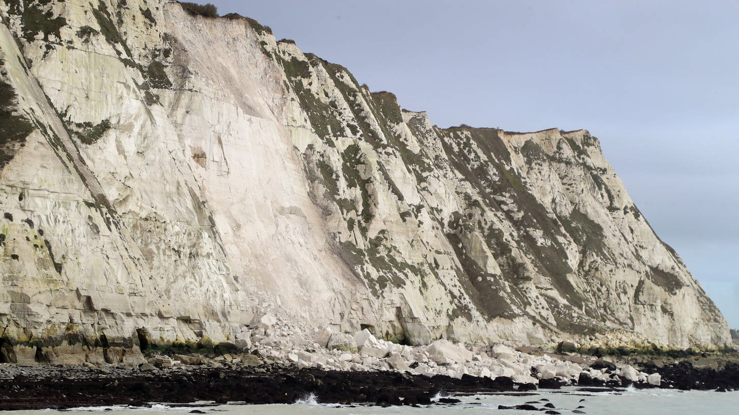 Grid laughs at a broken piece of chalk cliff in Dover SWR3