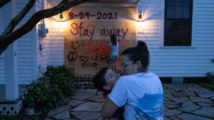 STAY AWAY FROM IDA: New Orleans residents are securing their home before Hurricane Ida.