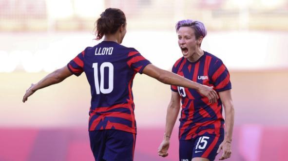 Megan Rapinoe (right) celebrates her dream goal for a 2-1 lead against Australia
