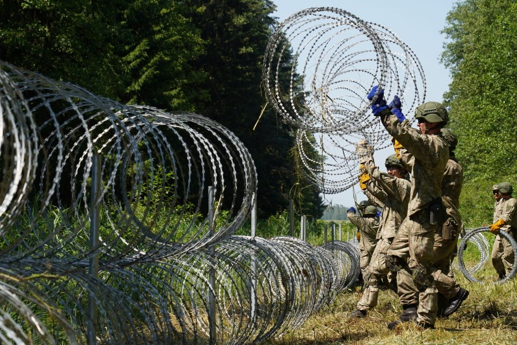 Vilnius says Belarusian border guards have breached the border and pushed migrants into Lithuania