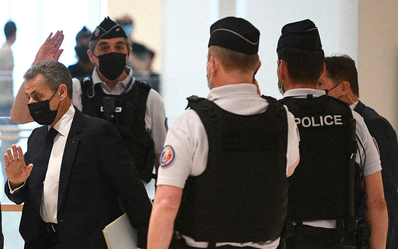 Nicolas Sarkozy arrives at his trial in the Pigalmion case in Paris on June 15, 2021