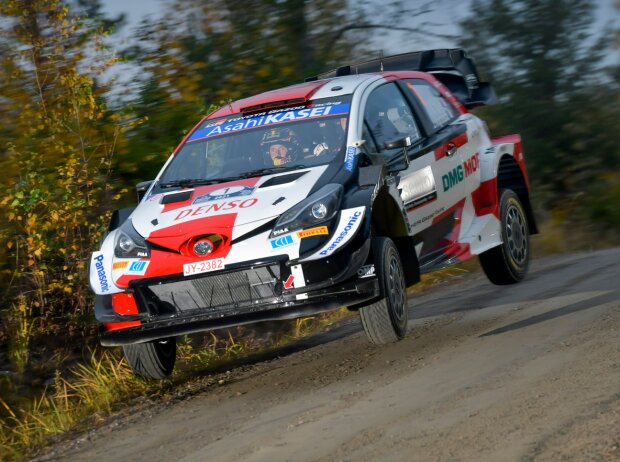 Sebastien Ogier jumps in his Toyota at the Rally Finland